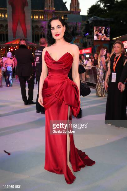 Dita Von Teese wearing dress by Lena Hoschek arrives for the Life Ball 2019 at City Hall on June 08, 2019 in Vienna, Austria. After 26 years the...
