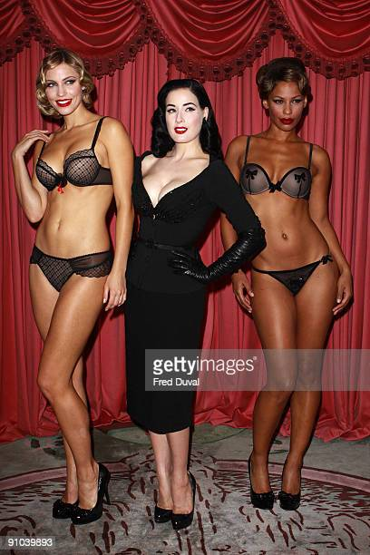 Dita Von Teese with models Amanda and Yazzy attends photocall to launch her new design for Wonderbra The Party Edition at The Dorchester on September...