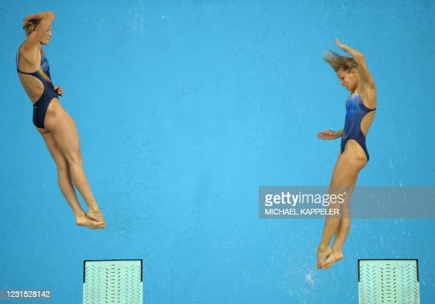 Ditte Kotzian and Heike Fischer of Germany compete in the women's synchronised 3m springboard diving competition final at the 2008 Beijing Olympic...
