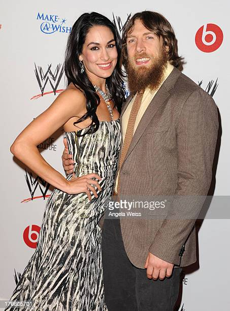 Diva Brie Bella and wrestler Daniel Bryan arrive at WWE and E Entertainment's 'Superstars For Hope' at Beverly Hills Hotel on August 15 2013 in...