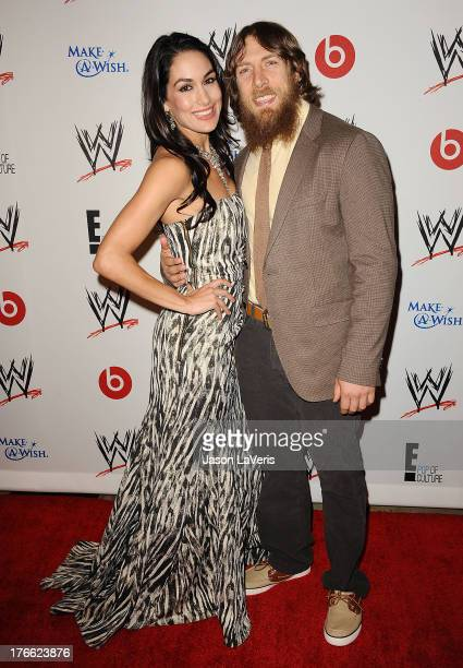 Diva Brie Bella and wrestler Daniel Bryan attend the WWE SummerSlam VIP party at Beverly Hills Hotel on August 15 2013 in Beverly Hills California