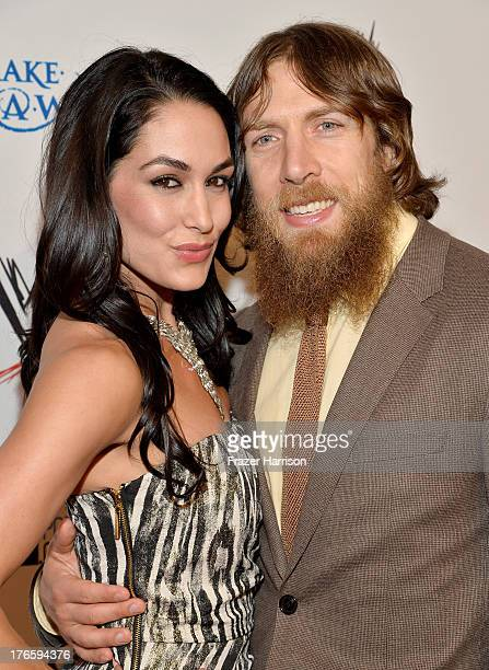 """Diva Brie Bella and wrestler Daniel Bryan attend WWE & E! Entertainment's """"SuperStars For Hope"""" at the Beverly Hills Hotel on August 15, 2013 in..."""