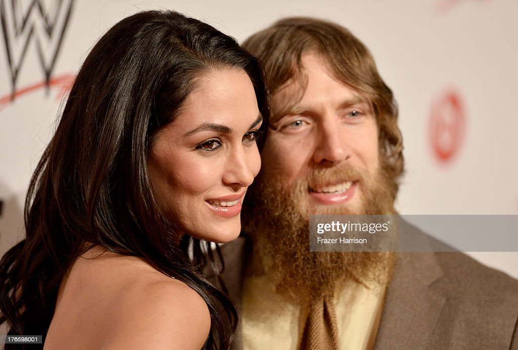 Diva Brie Bella (L) and wrestler Daniel Bryan attend WWE & E! Entertainment's 'SuperStars For Hope' at the Beverly Hills Hotel on August 15, 2013 in Beverly Hills, California.