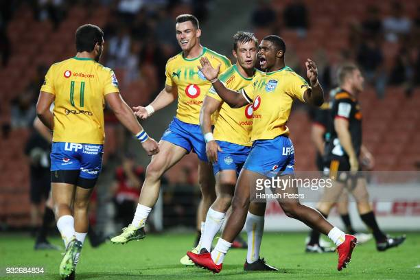 Divan Rossouw celebrates with Warrick Gelant of the Bulls after scoring a try during the round five Super Rugby match between the Chiefs and the...