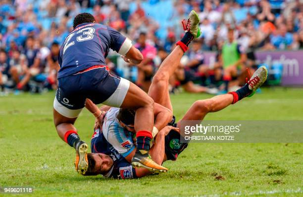 Divan Rossouw of the Bulls is tackled by Jack Maddocks of the Rebels during the Super Rugby rugby union match between South Africa's Bulls and...