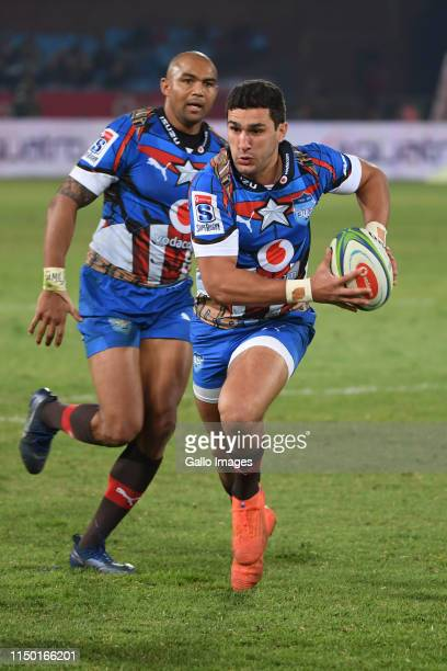 Divan Rossouw of the Bulls runs with the ball during the Super Rugby match between Vodacom Bulls and Emirates Lions at Loftus Versfeld on June 15,...