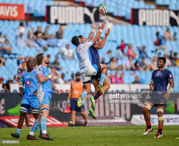 Divan Rossouw of the Vodacom Bulls and Jack Maddocks of the Rebels jump for the high ball during their Super Rugby 2018 match between the Bulls and...