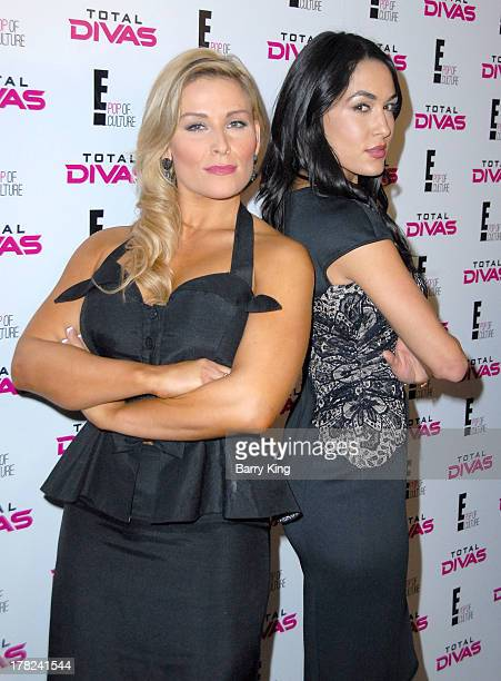 Divas Natalya and Brie Bella attend the WWE SummerSlam Press Conference on August 13 2013 at the Beverly Hills Hotel in Beverly Hills California