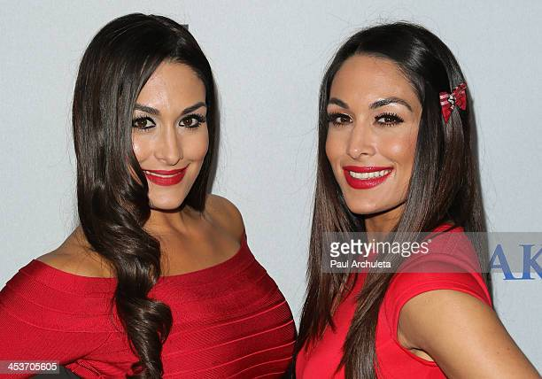 Diva's Nicole Bella and Brianna Bella attends The MakeAWish Foundation of greater Los Angeles 2013 Wishing Well Winter Gala at The Regent Beverly...