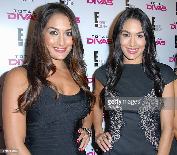 Divas Nikki Bella and Brie Bella of The Bella Twins attend the WWE SummerSlam Press Conference on August 13 2013 at the Beverly Hills Hotel in...