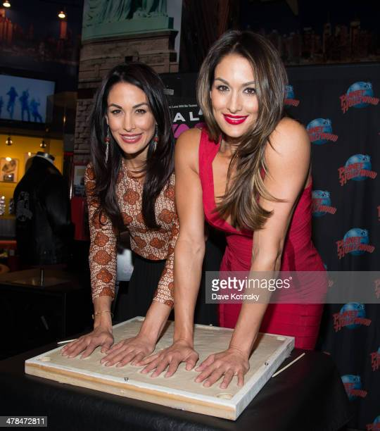 Divas The Bella Twins Nikki Bella and Brie Bella visits at Planet Hollywood Times Square on March 13 2014 in New York City