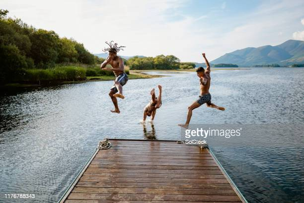 dive bomb - jumping stock pictures, royalty-free photos & images