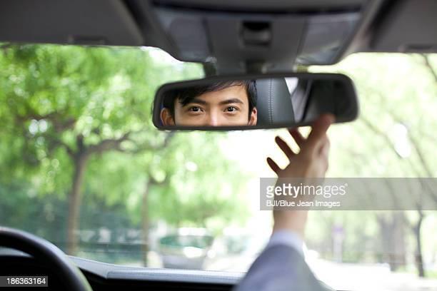 Diver adjusting rear view mirror