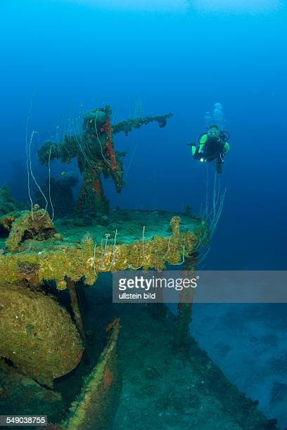 Diver and Anti Aircraft Machine Gun at Destroyer USS Lamson, Marshall Islands, Bikini Atoll, Micronesia, Pacific Ocean