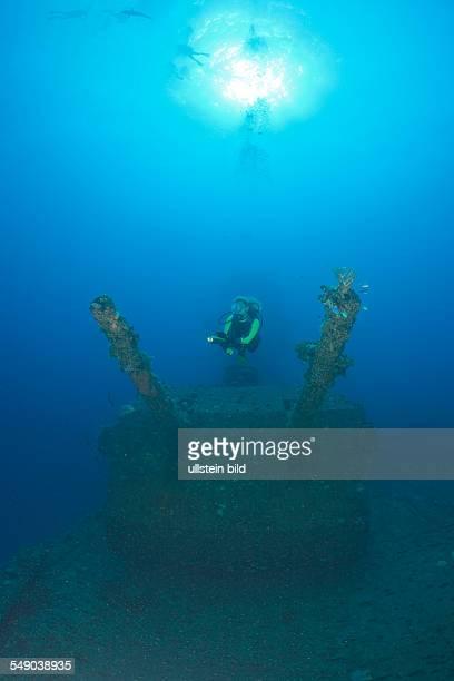 Diver and Twin 8inch 55 caliber Gun on USS Saratoga Marshall Islands Bikini Atoll Micronesia Pacific Ocean