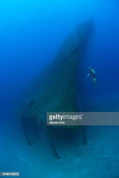 Diver at Bow of USS Arkansas Battleship Marshall Islands Bikini Atoll Micronesia Pacific Ocean