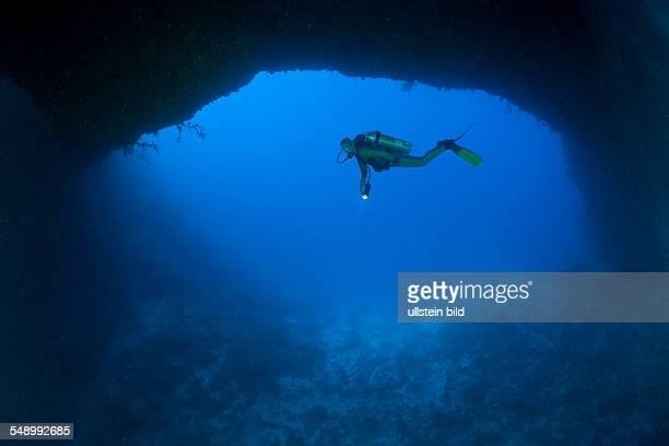 Diver at wide bottom Hole of Blue Hole Cave, Micronesia, Palau