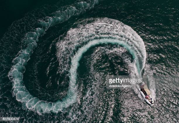 A diver boat is seen on Aegean Sea in Izmir Turkey on July 25 2017 In Summer's extreme hot days people try to cool themselves off with various sea...