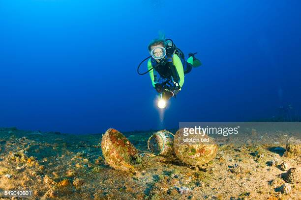 Diver discover Tableware at Destroyer USS Anderson Marshall Islands Bikini Atoll Micronesia Pacific Ocean