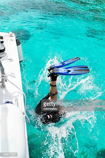 diver entering water for a diving excursion in the Caribbean