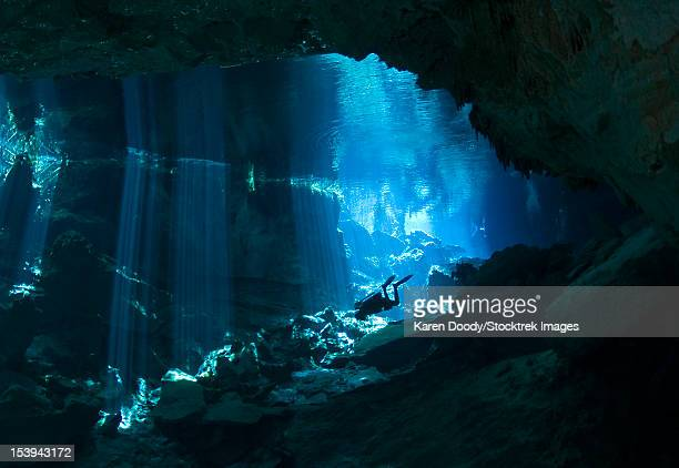 Diver enters the cavern system at Chac Mool cenote in the Riviera Maya area of Mexico's Yucatan Peninsula.