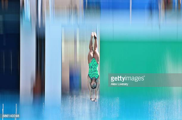 A diver enters the water during a training session at the Maria Lenk Aquatics Centre on August 5 2016 in Rio de Janeiro Brazil