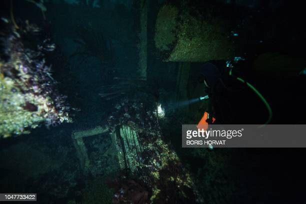 A diver explores the wreckage of the super tanker AmocoCadiz at 25 meters of depth off the coast of Portsall northwestern France on October 5 2018...