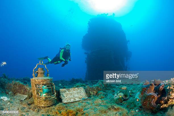 Diver finds Artifacts on Flight Deck of USS Saratoga, Marshall Islands, Bikini Atoll, Micronesia, Pacific Ocean