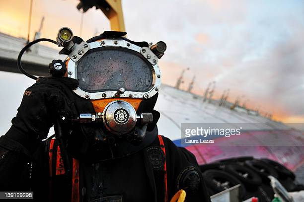 A diver from the Rotterdam based SMIT salvage firm works from a pontoon while taking part in the operation to remove fuel from the cruise ship Costa...
