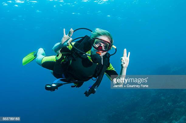 A diver gives the okay sign for the camera, St. Lucia.