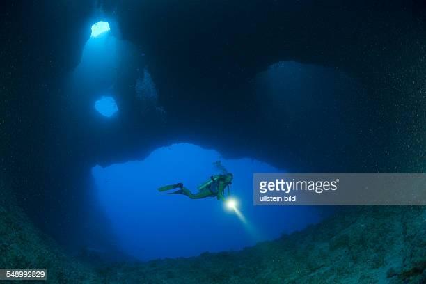Diver in Blue Hole Cave, Micronesia, Palau
