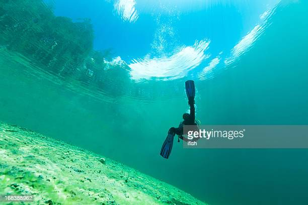 scuba diver in crystal clear water of lake samarang, austria - lake bottom stock photos and pictures