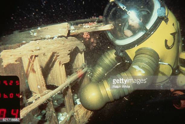 Diver in WASP Suit at Shipwreak