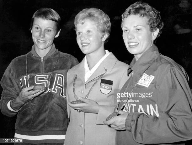 GDR diver Ingrid Kraemer wins the three metres springboard ahead of US Paula Pope and Britains's Elisabeth Ferris at the Olympic Games in Rome Italy...
