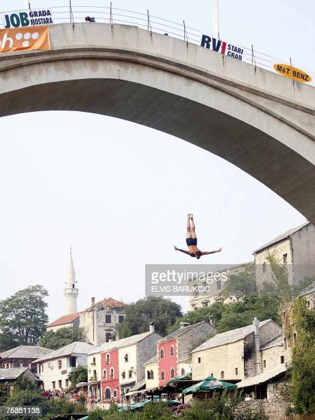 Diver jumps from the 40 meter high Old Mostar Bridge during the High Diving competition, 75 kms south of Bosnian capital of Sarajevo, 29 July, 2007....