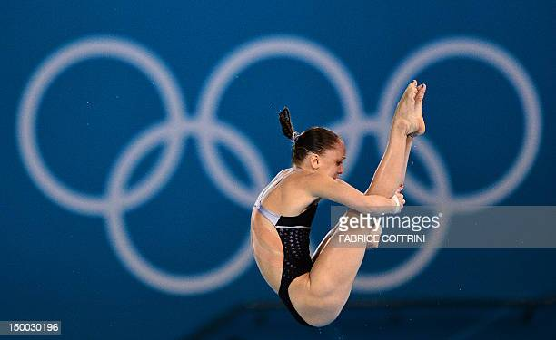 US diver Katie Bell competes in the women's 10m platform semifinals during the diving event at the London 2012 Olympic Games on August 9 2012 in...