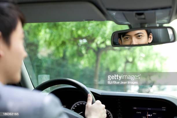 Diver looking at rear view mirror