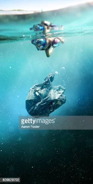 Diver looking at rubbish