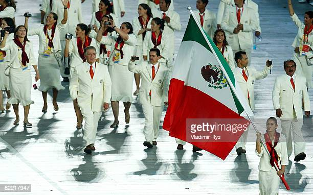Diver Paola Espinoza Sanchez of Mexico carries her country's flag during the Opening Ceremony for the 2008 Beijing Summer Olympics at the National...