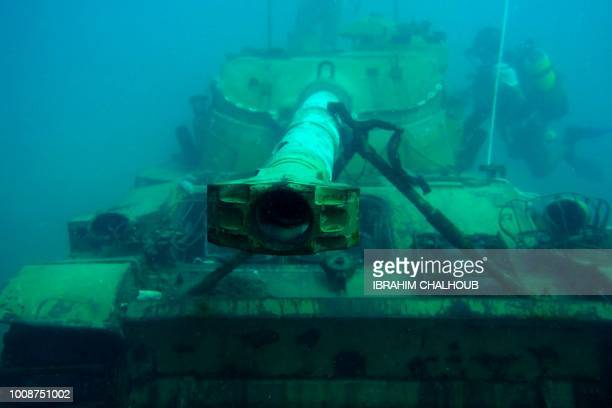 A diver progresses around an immersed tank off the coast of the southern Lebanese port city of Sidon on August 1 2018 Environmental activists on July...
