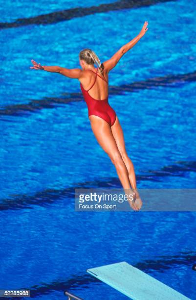 A diver shows excellent form after leaving the board during the Summer Olympics XXIII circa 1984 in Los Angeles California