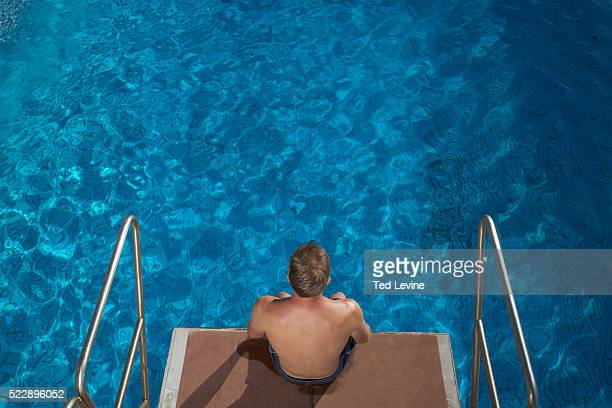 Diver Sitting on Diving Platform