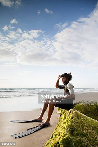 Diver sitting on rock, Palm Beach, Florida, USA