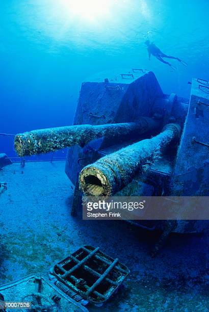 Diver swimming close to wreckage of Russian Destroyer, Cayman Islands