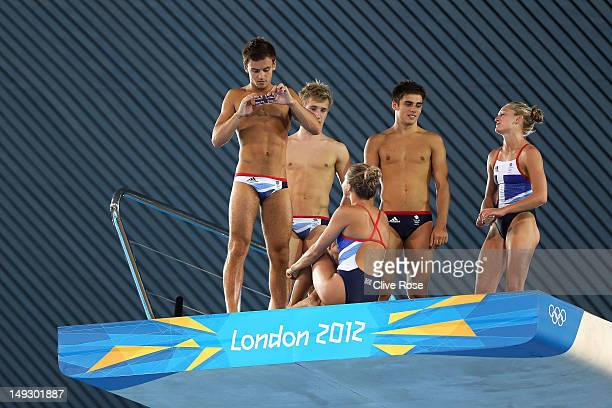 Diver Tom Daley of Great Britain takes a pictures with his team mates on the diving platform with his camera on his smartphone during a training...