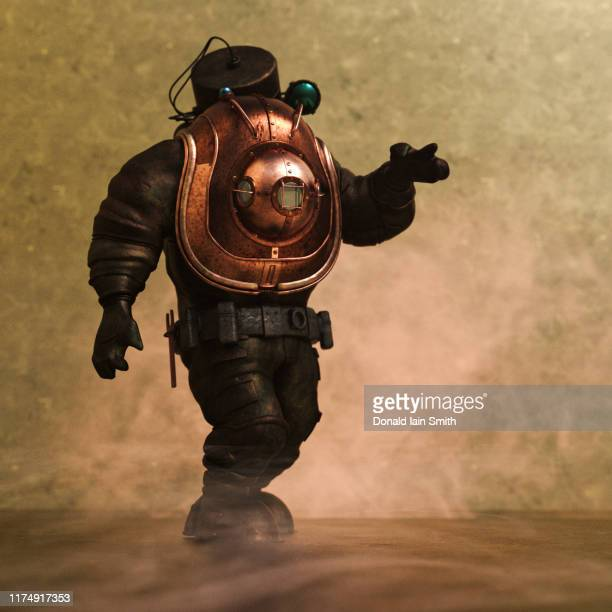 diver walking in old style diving suit - aqualung diving equipment stock pictures, royalty-free photos & images