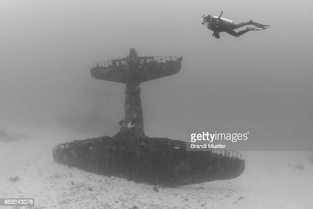 Diver with Douglass Dauntless WWII Airplane Underwater
