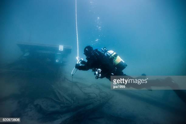 Diver working on dark waters