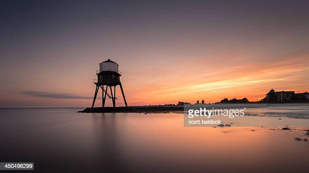 CONTENT] Divercourt Victorian lighthouse at sunset in harwich essex uk Long exposure seascape landscape Colour