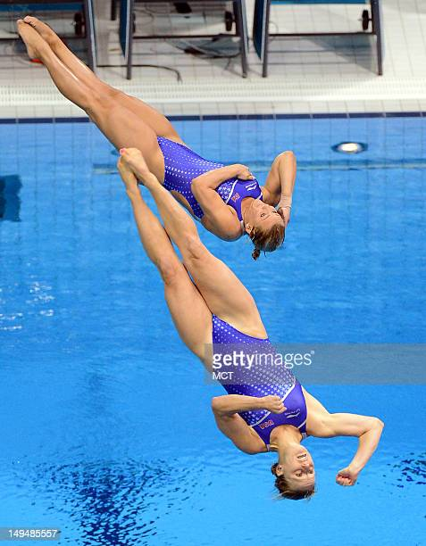 USA divers Abigail Johnston and Kelci Bryant execute a forward two and a half somersault with one twist dive during the Women's Synchronized 3 meter...